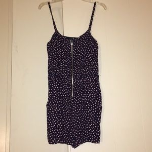 Size small romper. never worn. good condition.